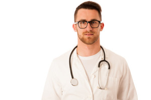 55100611 - handsome doctor in white robe with stethoscope around neck isolated over white.